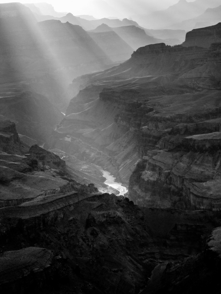 sun rays rays illuminating the Colorado river at Grand Canyon, USA - www.albertomesircaphoto.com