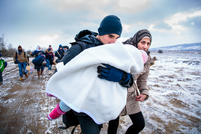 After crossing the Macedonian-Serbian border, refugees walk the unofficial refugee route in subfreezing snowy weather. Near Miratovac, Serbia, January 17, 2016.  According to UNHCR, 67,415 refugees landed in Greece in January 2016 alone, most of who traveled the route through Serbia on their way to Western Europe. The number of refugees arriving in Greece has dropped significantly since the Balkan border closures in March 2016. On assignment for Mercy Corps, I documented refugees crossing through Serbia in January 2016.