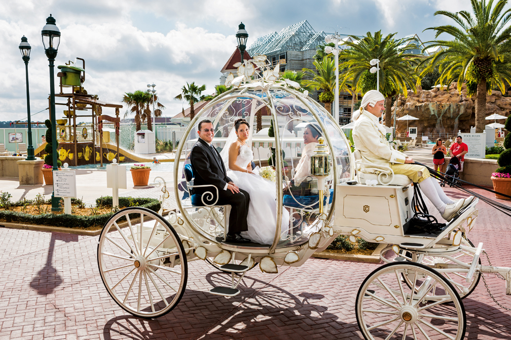 Christina Alaniz, soon to be Mrs. Torres, and her parents take Cinderella's glass coach to the ceremony, the grand method of transportation Christina chose as part of her Disney's Fairy Tale Wedding package.  Disney was a big part of their family vacations when Christina was growing up, but when they fell into a financial slump; they were unable to visit for several years.  This time, Christina, who is financially independent, brought her parents, which was very special for her to give them that gift.