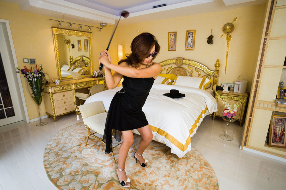 Yvonne Xue, 44, board chairman general manager of Shanghai Si Tong Cable Industry and vice board chairman of Shanghai Huiyang Industry Company, photographed in her designer home in Shanghai. Yvonne's bedroom is decorated with a complete Versace bedroom set., 2005.