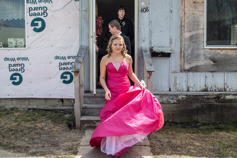 Bailey Morton, followed by her date Trevor Carlson and friend Cole Hilpipre, leaves for her senior prom on Saturday, April 27, 2013 in Webster City, IA.