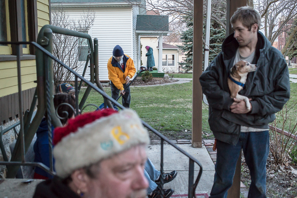 Steve, Mark, and Dustin sit outside the house they live in as an elderly neighbor comes home in the evening on Thursday, April 25, 2013 in Webster City, IA.
