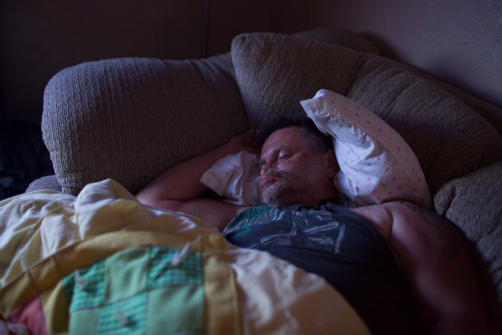 Kevin Reed sleeps on a friend's couch after being evicted from his apartment on Monday, July 16, 2012 in Webster City, IA.