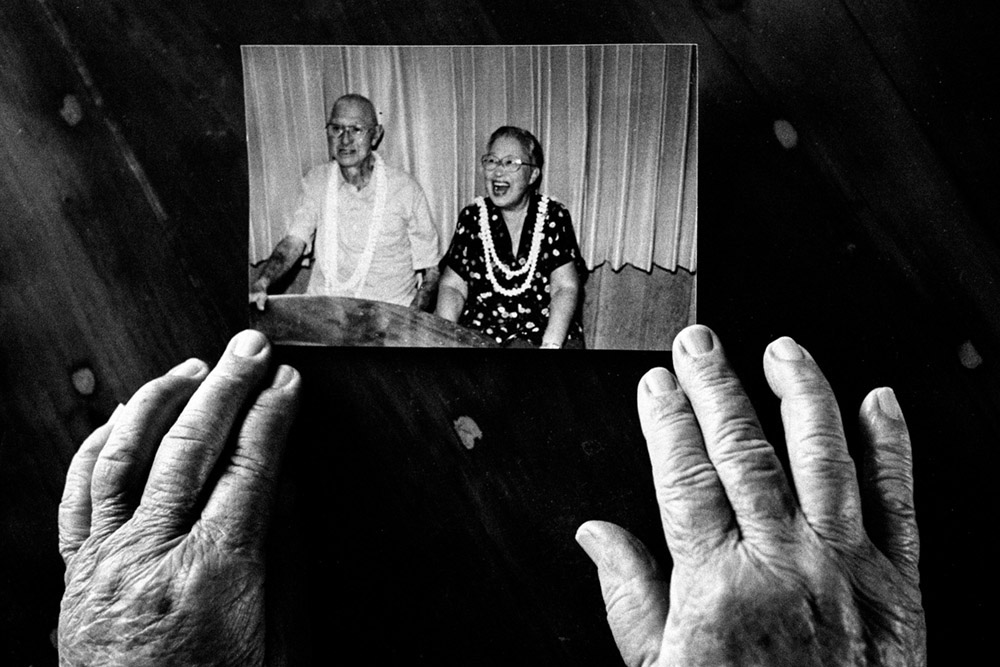 Lily glances over an old photograph of her and Kenneth, her late husband.  Over a decade ago, she lost him to Parkinsons and Alzheimer's disease.