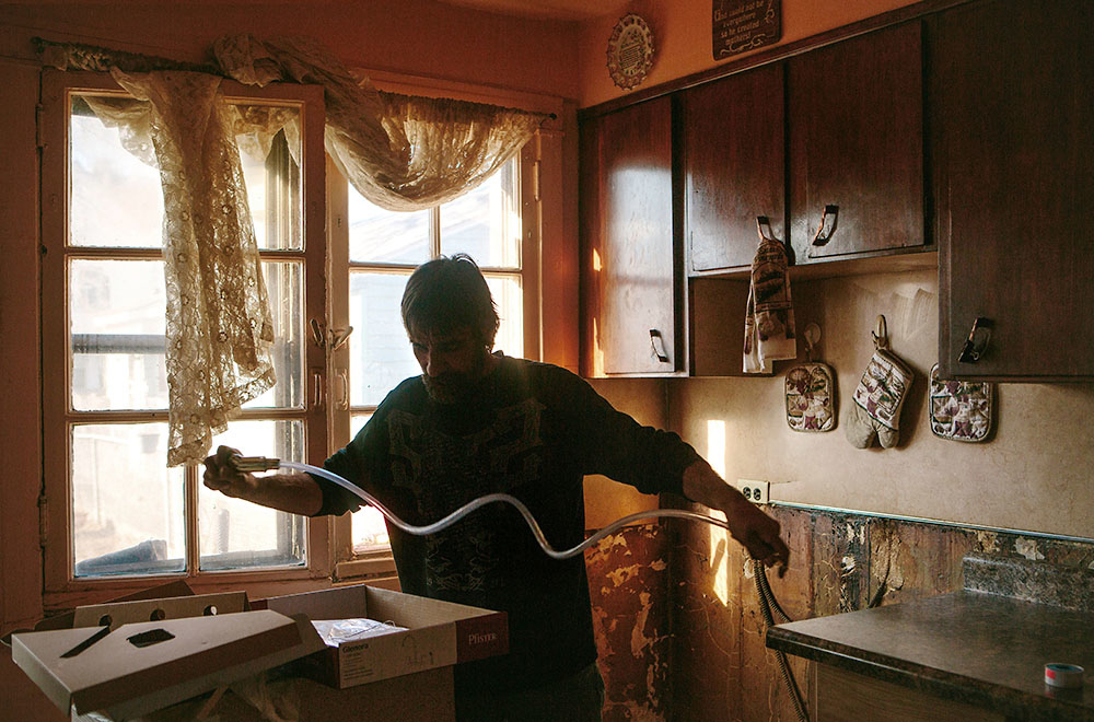 Though the home's future is uncertain, Michael Unger installs a new sink and cabinets in the kitchen of his childhood home where he lives with his sister Kim Rodriguez. |||| American industry disproportionately affects the health of minority and low-income communities, and East Chicago, Ind. ó known as the countryís ìmost industrialized municipalityî during the Industrial Revolution ó offers a view of environmental injustices emerging throughout the Rust Belt.
