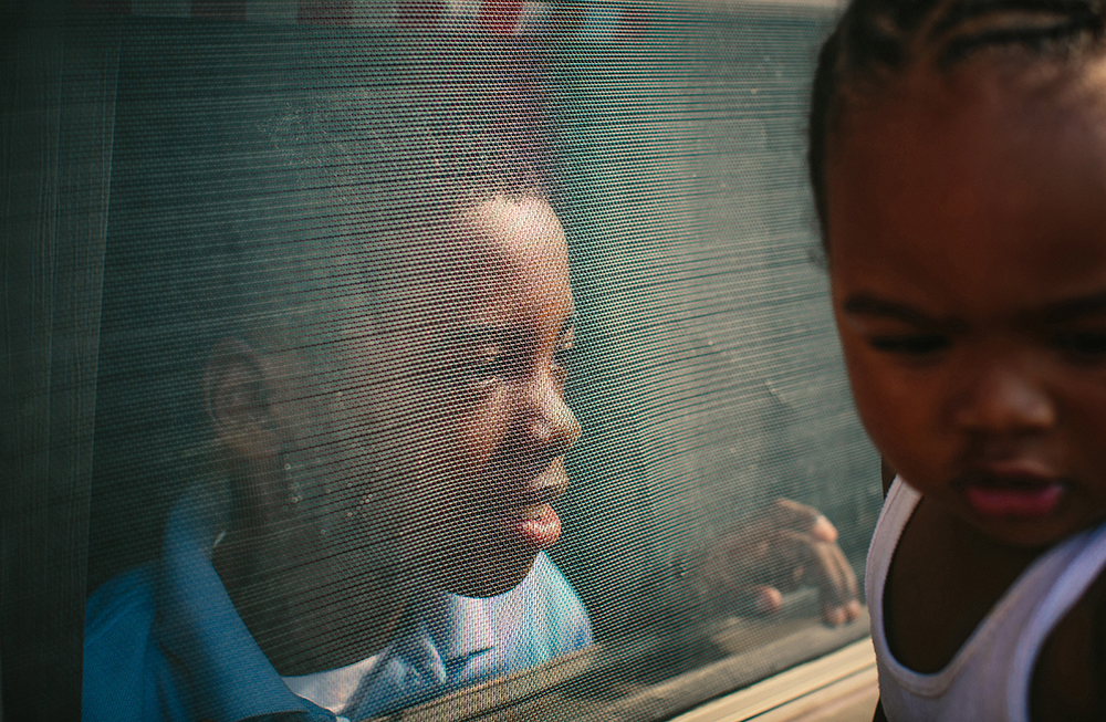 Logan Anderson, 19 months, plays with his older brother Lamont Anderson Jr., 8, at the West Calumet Housing Complex in East Chicago, Indiana. Anderson Jr.'s blood lead levels test results were above the CDCís 5 mg/d threshold for action. After living in the complex for more than a decade, the family moved to Gary, Indiana earlier this summer.  |||| American industry disproportionately affects the health of minority and low-income communities, and East Chicago, Ind. ó known as the countryís ìmost industrialized municipalityî during the Industrial Revolution ó offers a view of environmental injustices emerging throughout the Rust Belt.