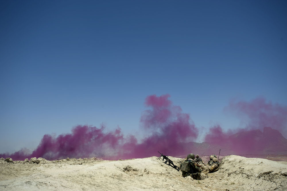Purple smoke marks Afghan and Canadian soldiers positions while a drone strike takes place nearby on insurgents in Panjwa'i District, Kandahar, Afghanistan. (Credit Image: © Louie Palu/ZUMA Press) FROM THE BOOK FRONT TOWARDS ENEMY. USE RESTRICTED TO BOOK REVIEWS ONLY