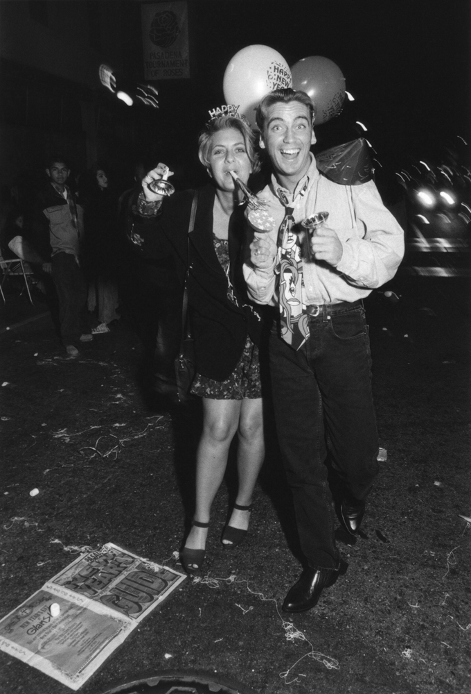 New Year's 1994, Pasadena, California Festive Couple with Noisemakers and Balloons on Colorado Avenue