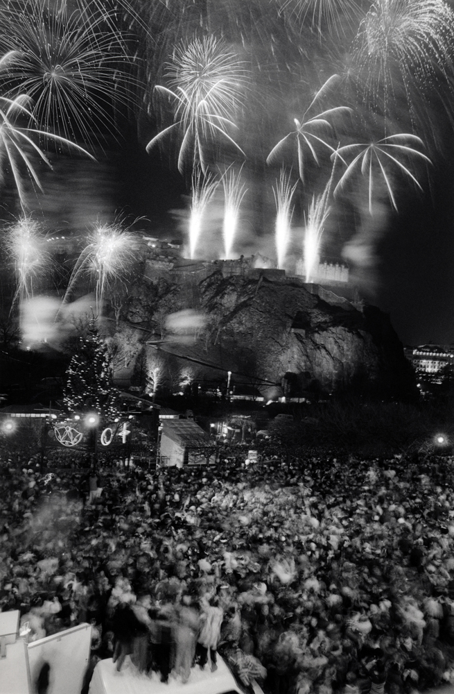 New Year's Eve 1999, Edinburgh, Scotland Fireworks over Edinburgh Castle at Midnight with Princes Street Garden Crowds Cheering Below