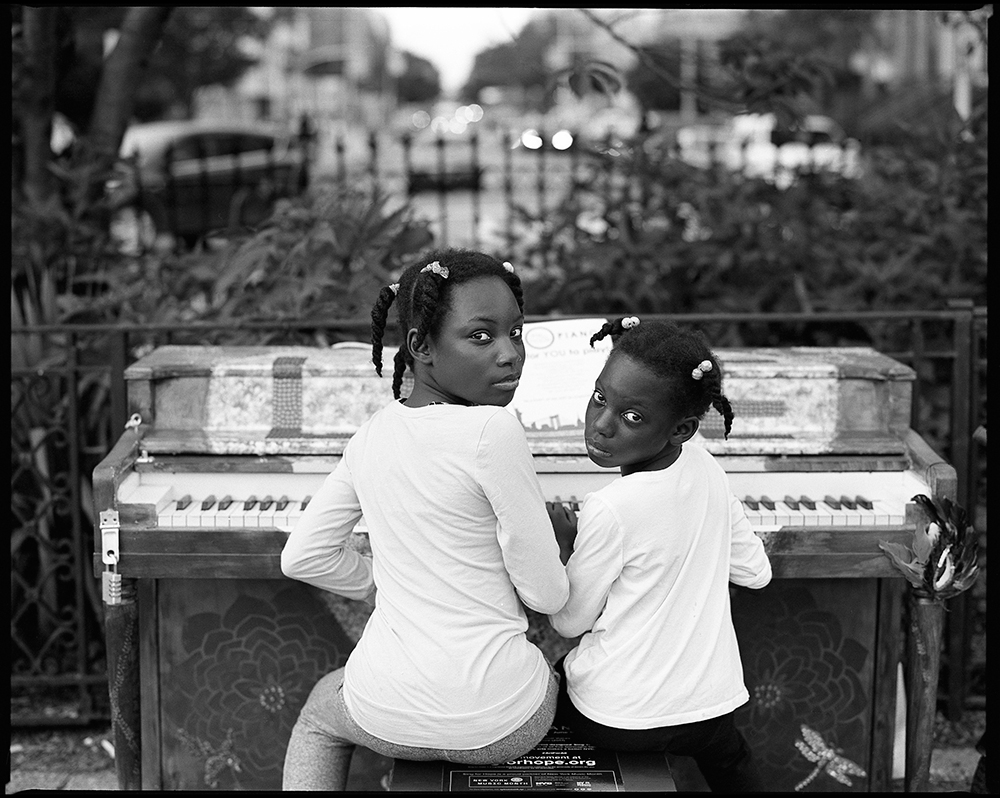Two Girls and a Purple Piano