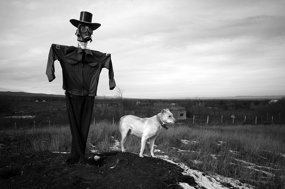 Bamut, Chechnia, Stanley Greene ©NOORIMAGES 2013 A scarecrow and his guard dog watch over the village of Bamut, which was always a rebel stronghold, and was the last village to fall to Russian forces. The entire village was leveled by the Russian military. Bamut is near the Chechen border with neighboring Ingushetia, which lies to the west of Chechnya. In April 2014, Chechen President Ramzan Kadyrov sent forces on a cross-border raid into Ingushetia. A few years previously, he sent forces on a similar raid into Dagestan, to the east. Kadyrov's pan-Caucasus ambitions are making his neighbors uneasy. Bamut, Chechnya, 2013.