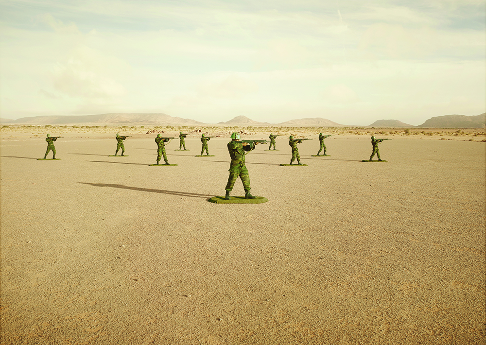 "Polisario Soldiers In Western Sahara. Toy Soldiers Budraiga No.02. ""Toy Soldiers"" is a unique collaboration between a military commander and an artist in the creation of an allegory of modern warfare that stages real soldiers, posed as toy soldiers, in an investigation into the impact, legacy and dehumanizing effects of war. The series is set in Western Sahara, an invisible conflict stuck within a paradigm of post-colonial conflict for over 40 years."