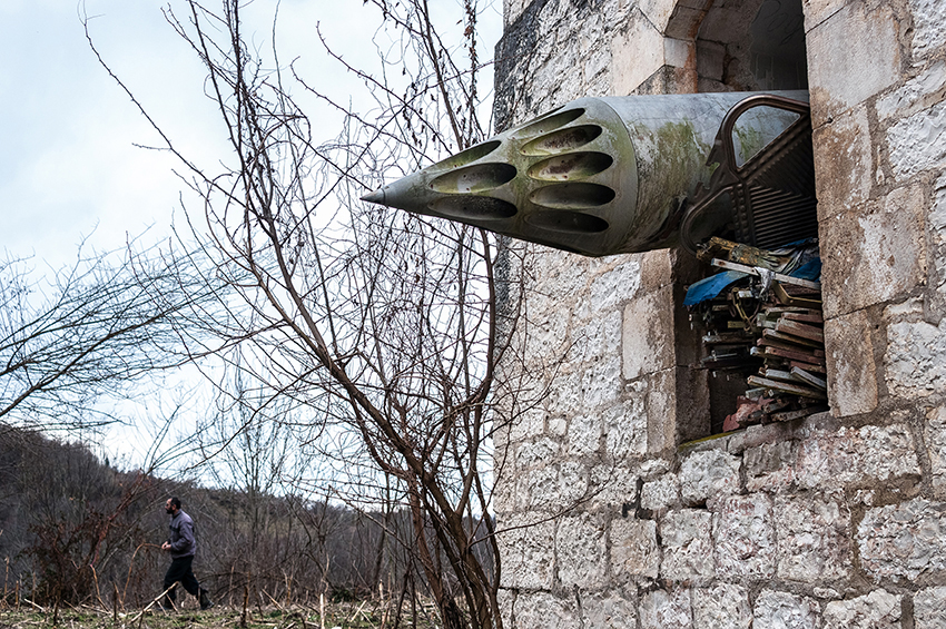 An unguided missile launching mount, left in an Orthodox church destroyed during the war. Anukhva, Abkhazia. 2013