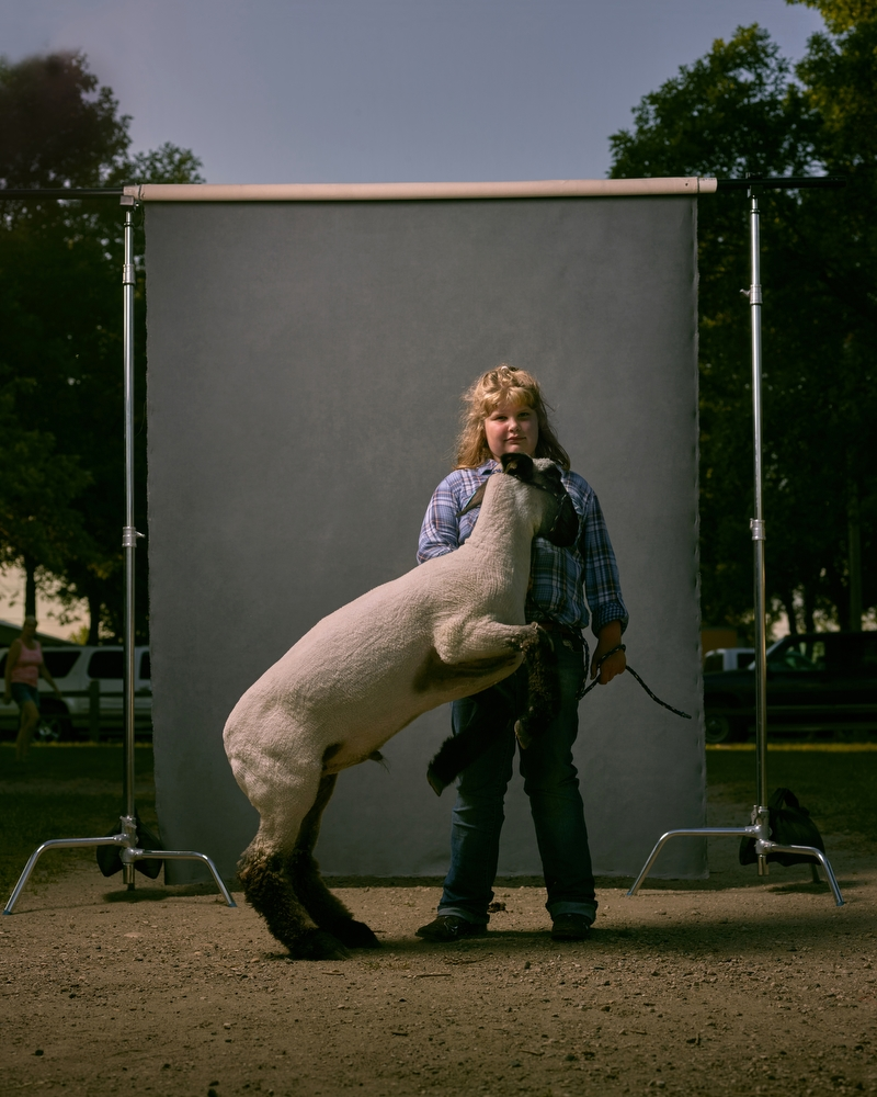 "Carolana and Sheep, West Otter Tail County Fair, Minnesota, 2016. From the project, ""The Unchosen Ones."""