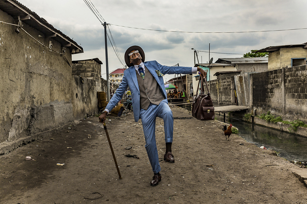 Elie, 45, struts his stuff in the streets of Brazzaville. He has been a sapeur for 35 years and his elaborate outfits bring joy to himself and his community.