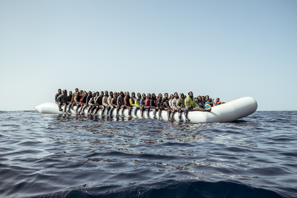 February 22nd 2017, Mediterranean Sea. A rubber boat adrift at sea, overloaded with migrants, photographed in international waters off the coast of Libya. Data on the rescues conducted by the rescue vessel Aquarius show that smugglers are increasing the number of migrants crammed in the inflatable boats used for the trafficking: up to 150 people in 12/15-meters long inflatable boats.