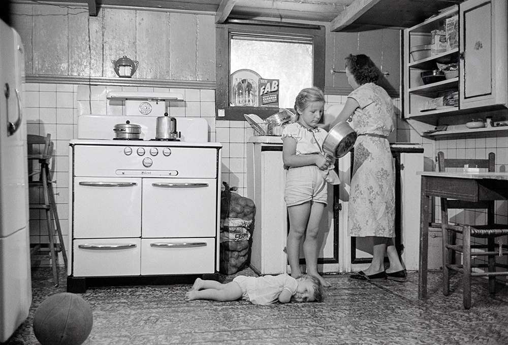 A family living on the Batture, an area between the levee and the Mississippi River near New Orleans. July, 1953. Photo by John G. Zimmerman
