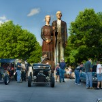 Seward Johnson's hysterical homage to Iowa painter Grant Wood looms over a car club meeting at the Iowa State Fairgrounds; Des Moines, Iowa USA ©Rich Frishman ALL RIGHTS RESERVED