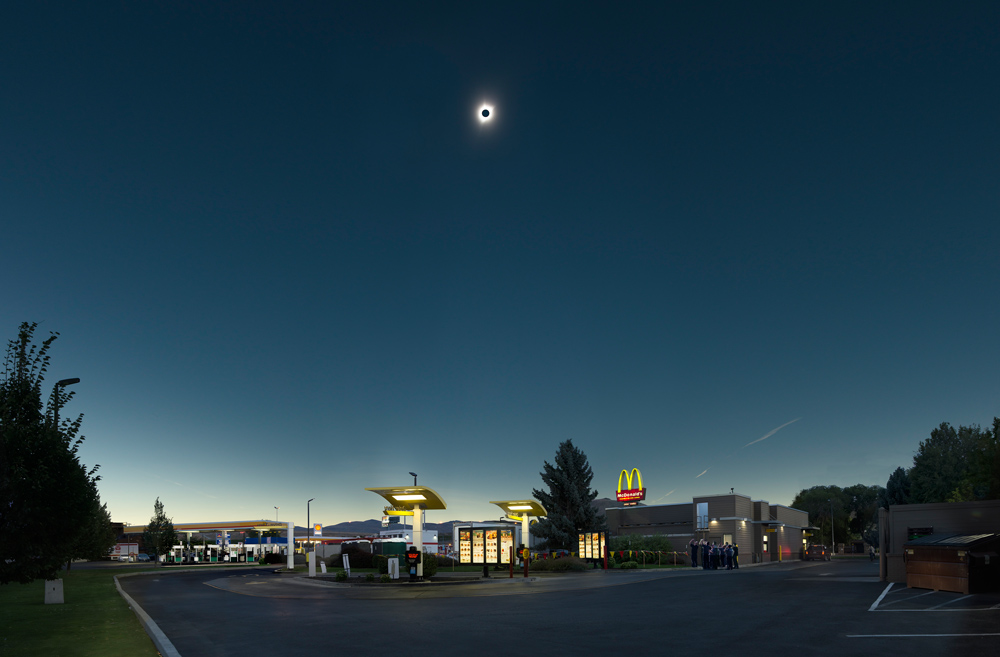 "Total solar eclipse over McDonald's; Baker City, Oregon. Celestial grandeur with a side of fries. I was reminded of Ansel Adams' ""Moonrise Over Hernandez."" ©Rich Frishman ALL RIGHTS RESERVED"