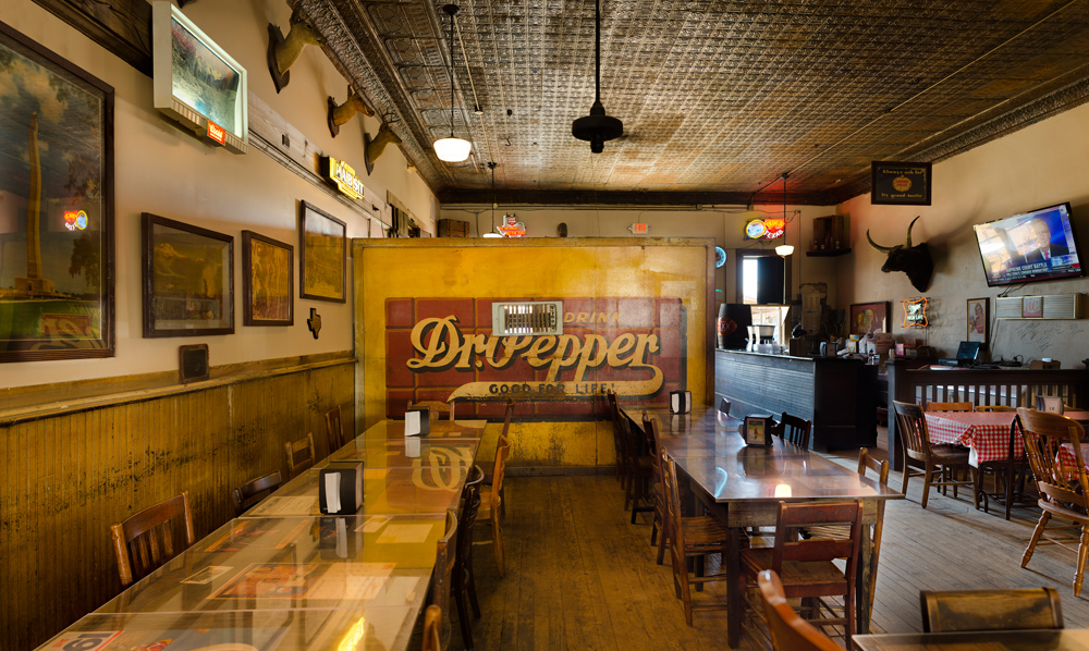 Segregation wall at Templin Saloon; Gonzales, Texas 2016 The wall was constructed in the early 20th Century and is decorated with an original pre-1929 Dr. Pepper logo. At the time of its construction (circa 1906) only Caucasian customers were allowed to sit in the front of the saloon. All Hispanic, Latino and African-American customers had to sit behind the wall. When the saloon was remodeled and re-opened in 2014 the wall, no longer used for its original purpose, was retained as a historical reminder. ©Rich Frishman ALL RIGHTS RESERVED