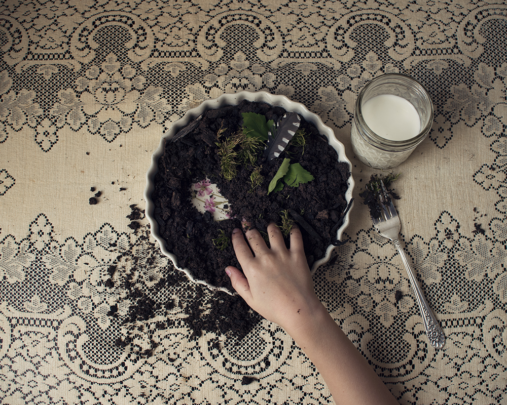 young girl with dirt pie