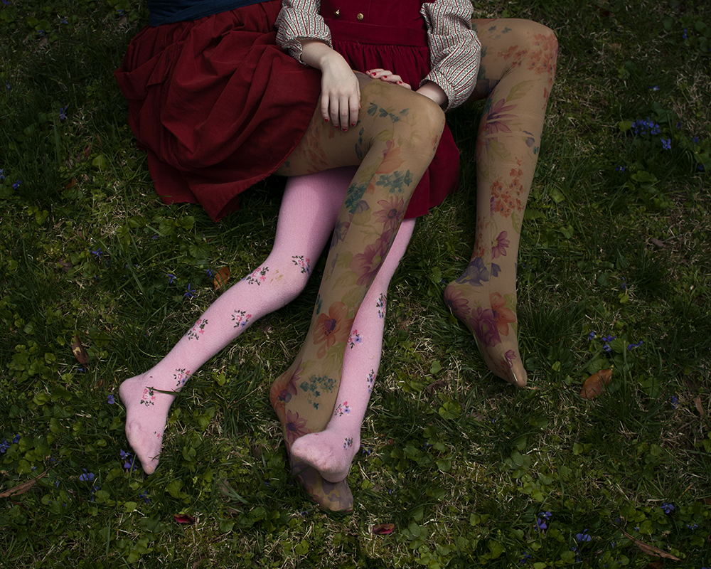 Mother and daughter with floral tights in the grass