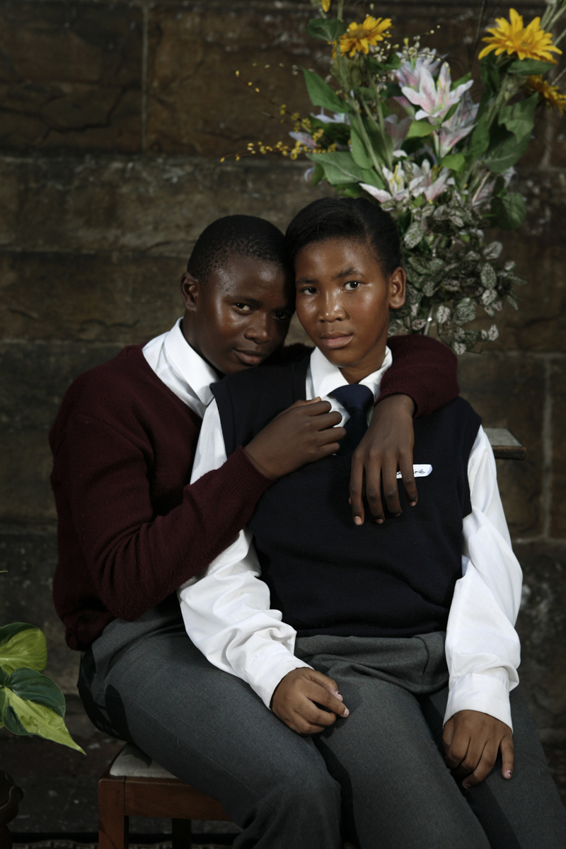 Ndumiso and Sibabalwe pose for their portrait outside St Georges Cathedral in Cape Town city center, February, 2013.  The images in this series are from street studios that were set up on street corners around South Africa over the course of 3 years. We invited passing families, individuals and groups of friends to pose at the temporary outdoor studios. The photos were then printed on site for free for people to take home for their family album.