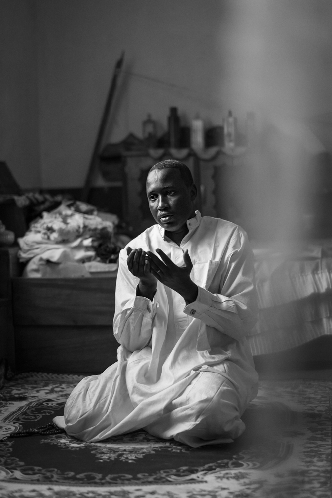 Ali, the leader of the muslim community of Bangassou, during his prayer. Despite the fact that the Seleka was a coalition of mostly Muslim armed groups, they also looted the house of Ali.