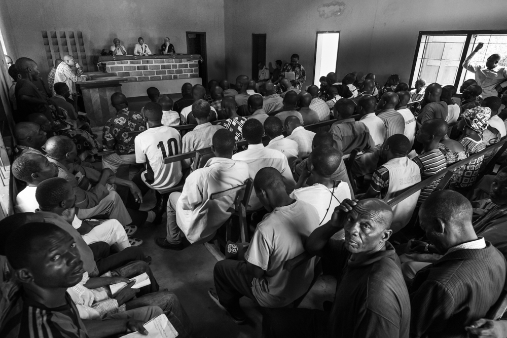 In anticipation of the elections that were to be held in October 2015, there is a meeting organized with the UN peacekeepers. The headmaster of the lyceum is reading the acts of the Bangui National Forum that was held on May 4-11th for the reconciliation process.
