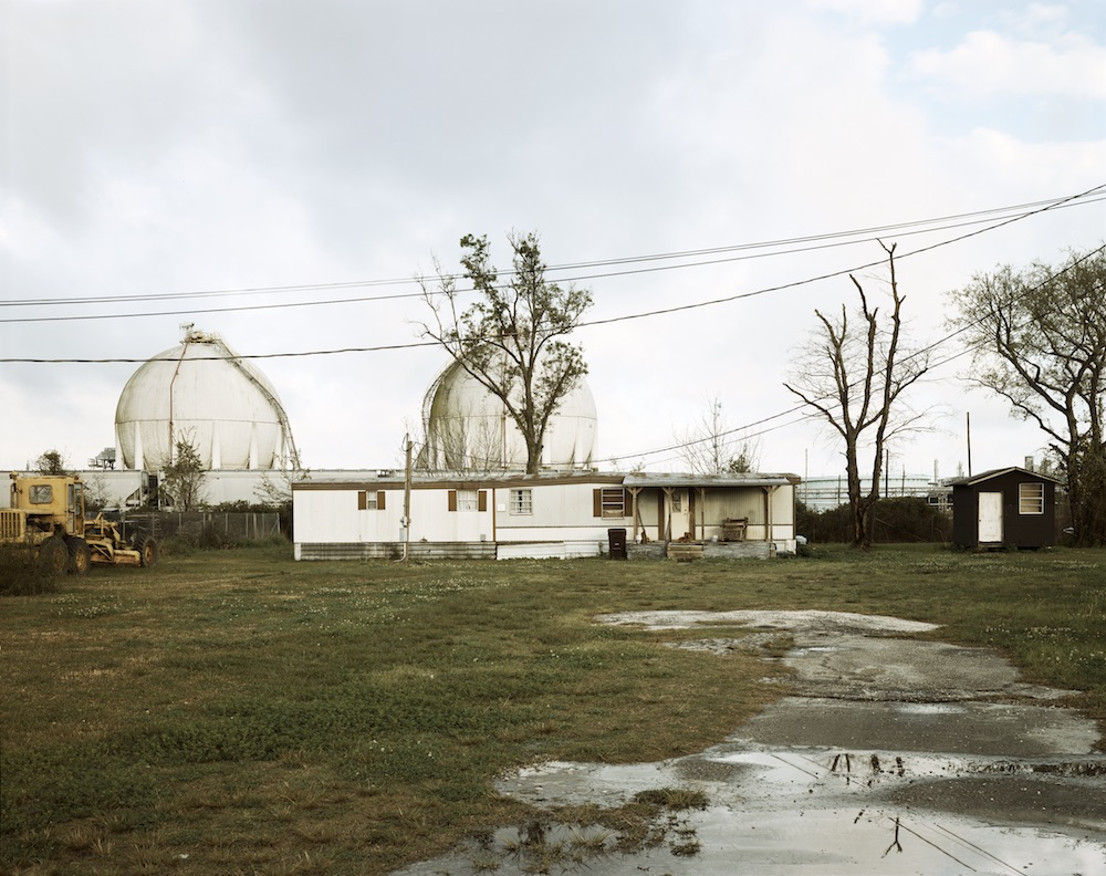 Trailer Home and Natural Gas Tanks, Good Hope Street, Norco, Louisiana, 1998, from Petrochemical America, photographs by Richard Misrach, Ecological Atlas by Kate Orff (Aperture 2012)