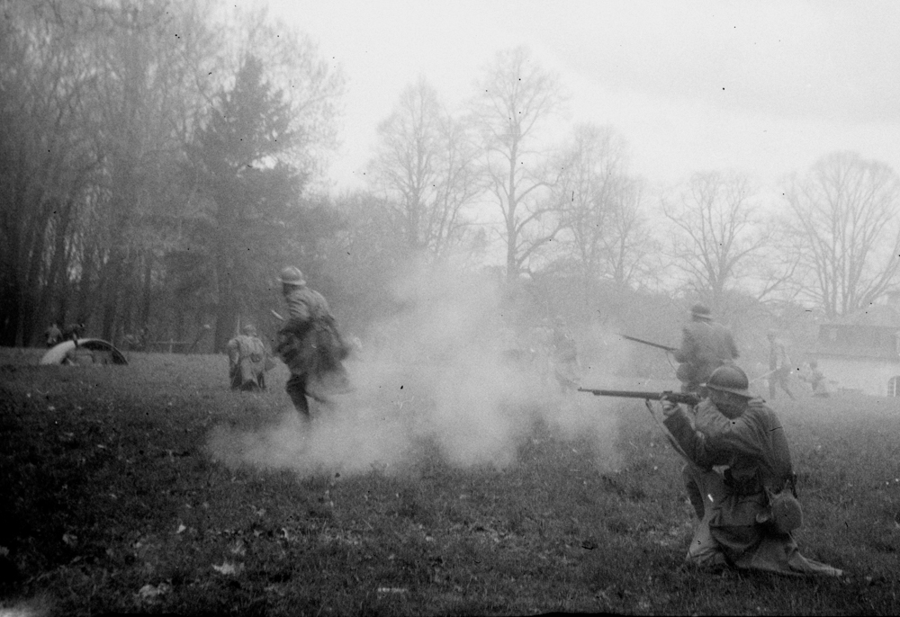 "French WWI reenactors attempt to contain a German attack of the hill Mt Renaud, Noyon, France, the same hill defended by real soldiers one hundred years before, April 2018. Photo taken with the Kodak Vest Pocket, a camera used during WWI. Photo taken with the Kodak Vest Pocket, also known as ""The Soldier's Kodak"", a camera largely used by combatants during WWI. The Vest Pocket produced a great deal of the amateur archival images of the conflict we have today. The image is part of the series ""Nostalgie de la boue"" (Nostalgia for Mud), a work in progress about memory a century after the end of the Great War."