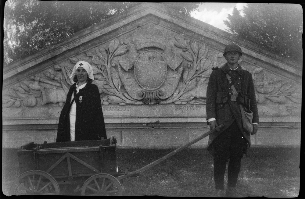 Jeremy and Aude, a young couple and reenactors, go to fetch food with a WWI cart in the streets of Saint Mihiel, a French village retaken from the Germans in September 1918 by American forces, near Verdun. Photo taken a hundred years after, in September 2018, with a century old Kodak Vest Pocket.