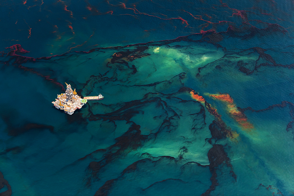 Oil spilled from the BP Deepwater Horizon wellhead rises up to the surface of the Gulf of Mexico near the Development Driller II platform, May, 2010. ©Daniel Beltra, courtesy Catherine Edelman Gallery, Chicago