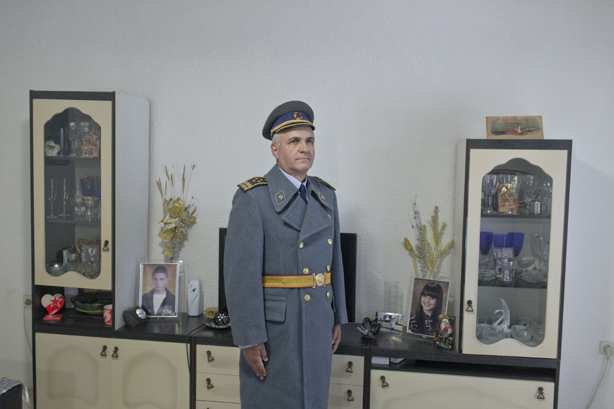 Gorgi Nikolov, nicknamed Tito, 58, a Yugoslav and a retired police officer, poses for a photograph inside his living room while wearing his Yugoslav era government issued winter uniform coat, Kocani, Macedonia, May 24, 2017. Nikolov, together with a group of friends, organizes and finances a private ceremony to commemorate the birthday of Josip Broz Tito, former Yugoslav leader, each May 25th, in the town of Kocani.