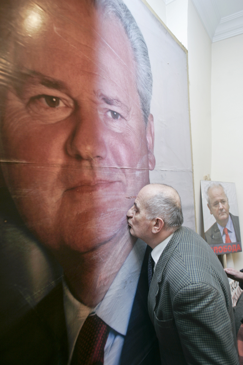 A man kisses a poster depicting Slobodan Milosevic, former Serbian strongman, upon hearing news of his passing in Belgrade, Serbia, March 11, 2006. Milosevic was the main driving force behind the bloody breakup of Yugoslavia, stirring and exploiting hardline nationalist sentiment in Serbia, the biggest and the most populous of the six Yugoslav republics.