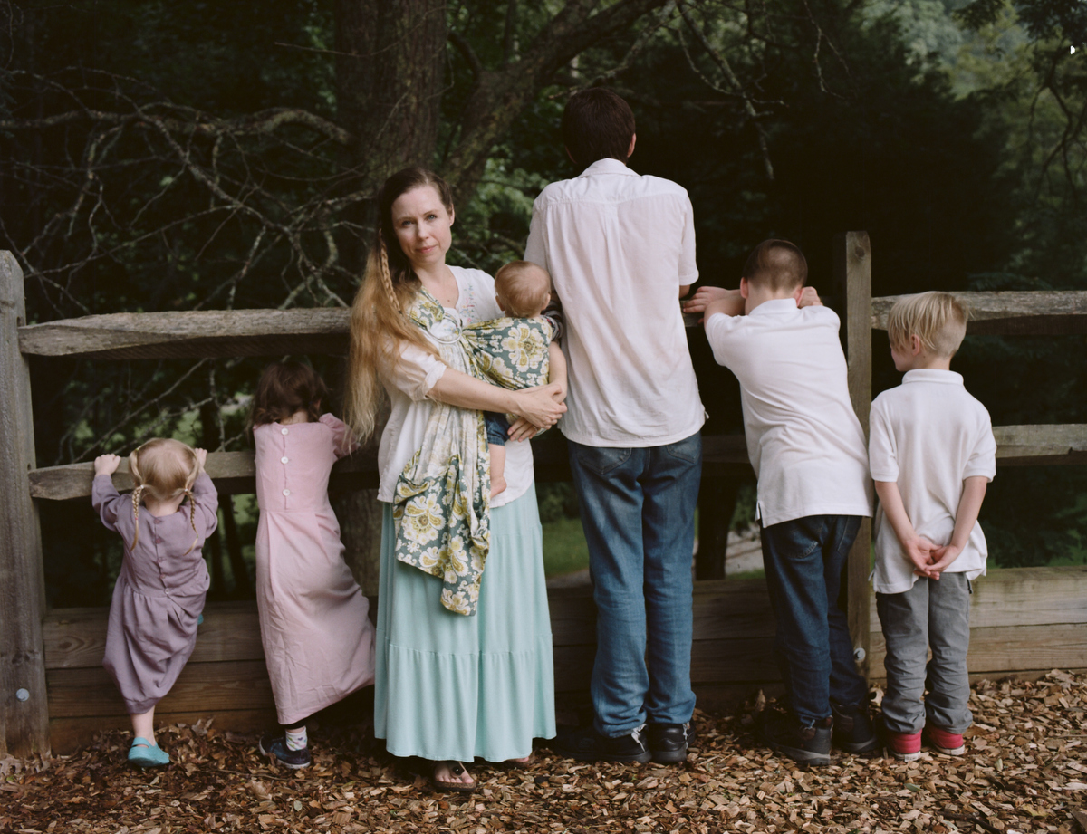 """A Wife With a Purpose,"" the online super star Ayla Stewart, poses for a portrait at a public park in Tennessee on August 23, 2017 along with her six children. She's known for promoting #tradlife (traditionalist homemaking and white culture). She's been kicked off twitter for hate speech, though has started accounts on Gab and other platforms, and continues to have a huge youtube following. Though she believes there are many definitions of the word Nazi, she says there is only one definition of the word racist and she claims she is not racist."