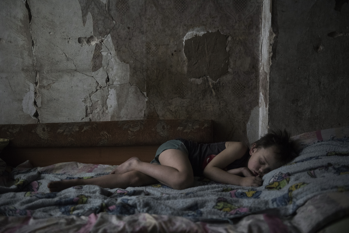 A child in a house near the front line. Outskirts of Donetsk. Ukraine