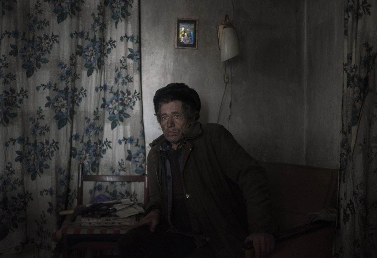 Alexander Zemlyanko, 63 years old. Lives alone. The house was badly damaged during the shelling. Village of Kominternovo, Donetsk region, Ukraine
