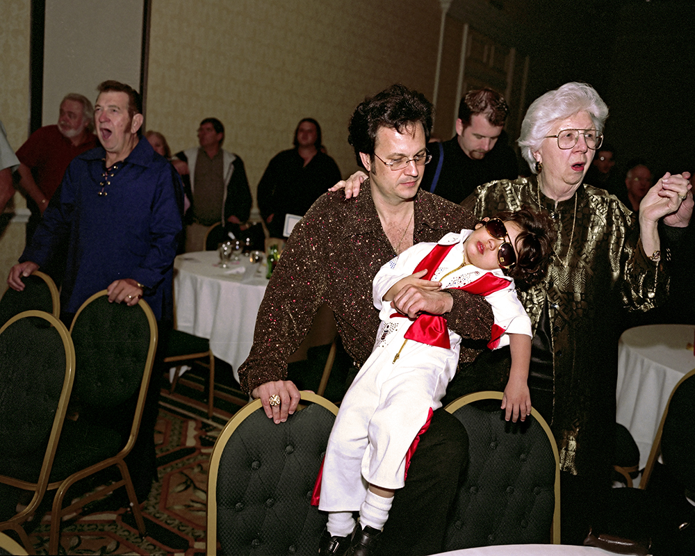 Sleeping Elvis, Kissimmee, Florida, 2005 During the closing ceremonies at the Elvis Presley fan club's dinner one erstwhile Elvis look-a-like can no longer stay awake.  On the right is Elvis Presley's last nurse, Marian Cocke.