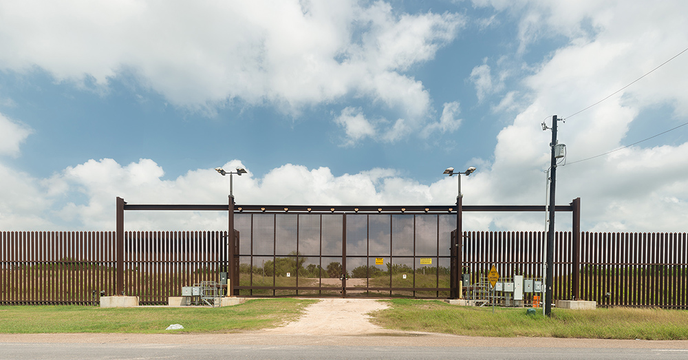 The United States government has recently begun fortifying the border between the US and Mexico. This new gate actually separates American farmers from their croplands just to the south, still in the United States. Nearby, in a former Walmart store, nearly 1500 immigrant children separated from their parents are incarcerated (as of July 2018.) ©Rich Frishman ALL RIGHTS RESERVED