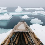 Traditional whaling is practiced in tune with the unpredictable weather of the Arctic. Wind has pushed floating ice near the shorefast ice and the whalers must wait until it shifts again, sometimes weeks later.