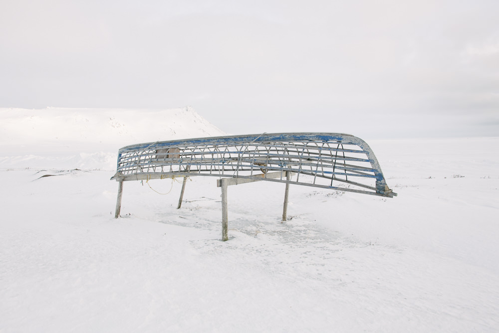 "The frame of a skinboat rests on trestles, a reminder of Yup'ik traditional culture. For the youngest generation of Yup'ik, traditional culture can be a lifeline. 16-year old Sam Schimmel from Gambell says, ""What I've seen is that when youth are not culturally engaged, you see higher rates of incarceration, higher rates of suicide, higher rates of alcoholism, higher rates of drug abuse — all these evils that come in and take the place of culture."""