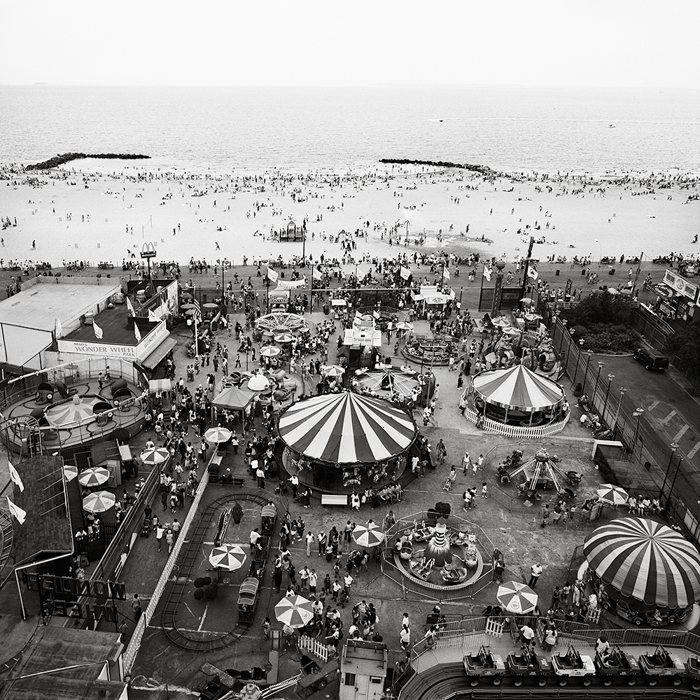 a view from the ferris wheel of Brooklyn New York's iconic Coney Island Amusement Park and beach
