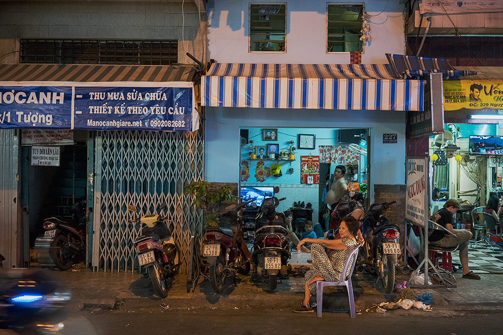 Night view of street and interior of house, HCMC, Vietnam