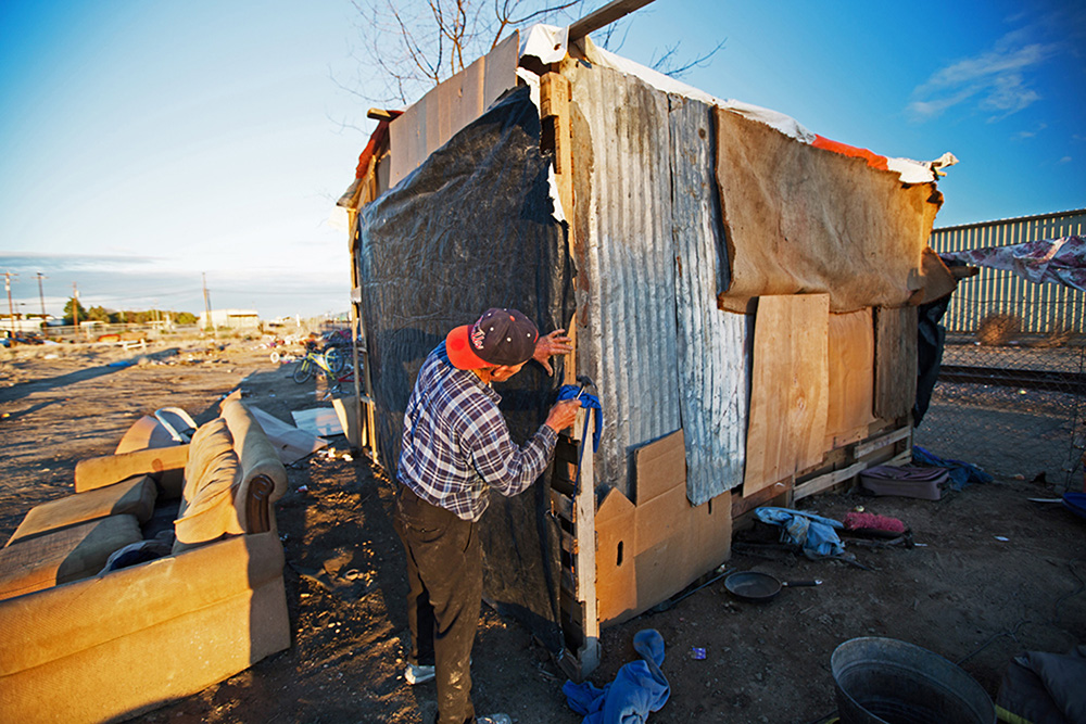 "A transient ettuce cut puts the finishing touches on his hand-built home in the ""Tumbleweed hotel."""