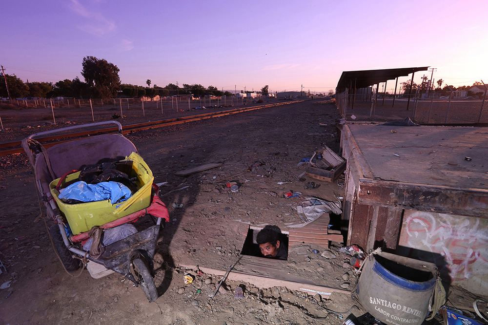 In Huron, the poortest town in California, Jose Martinez, 38, saves money on housing by living in a hole excavated beneath the concrete loading dock in the railroad yard.