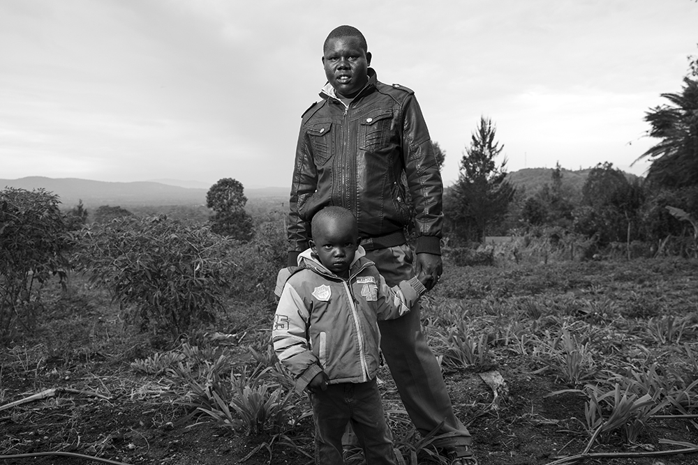 William Lokir stands with his son, Elias Korir. William's wife, Leah Lokir, died on February 19, 2018 while giving birth to their baby Bahati Chesista. William is now the caretaker of their 8 children.