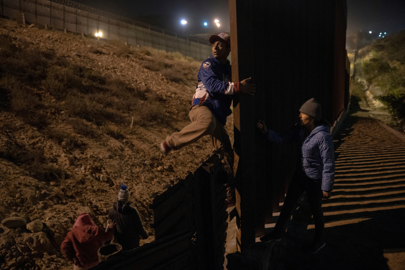 Migrants scope out and try to find a place to cross the U.S. - Mexican border wall near the beach in Tijuana, Mexico on December 16, 2018. Some attempt to dig under the wall, while others pass over it.  Photo by Kitra Cahana / MAPS