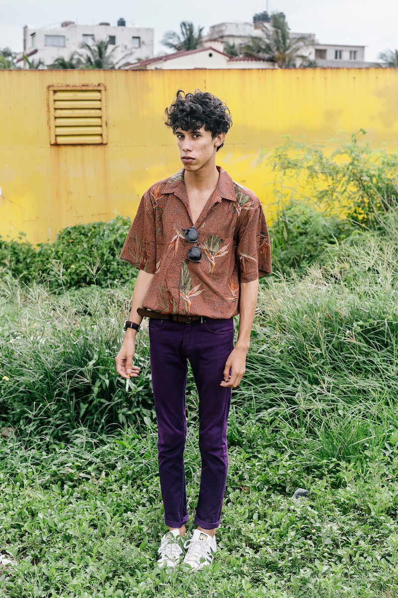 "Miguel Leyva, 22, a fashion blogger in Havana. Leyva says that the Cuban youth no longer look at magazines and see items as unattainable, but instead see styles they could eventually have.  Leyva also talked about clothing being a type of protest, ""Clothes have a strong connotation here, like a journalist writing an article against the government,"" Leyva said. ""It means to be free."""