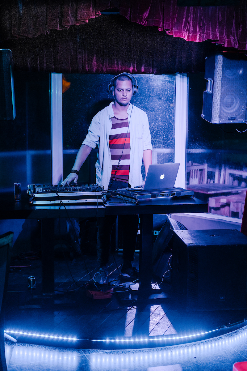 DJ Joan Coffigny spins deep house music during his set on the rooftop of Flauta Magica bar and Restaurant, across the street from the US Embassy in Havana, Cuba on March 5, 2017.
